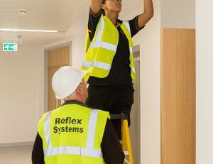 reflex-chloe-david-installing-fire-alarm